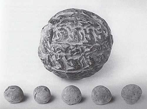 Envelope with its content of five spheres from Susa.